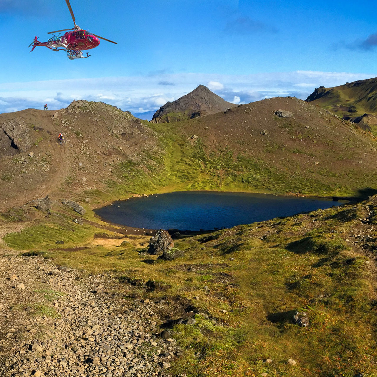 helicopter in air over lakes and craters