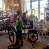 bike garage. mechanics work on mountain bikes for a tour